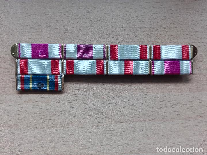 PASADOR CON 9 CONDECORACIONES. (Militar - Cintas de Medallas y Pasadores)