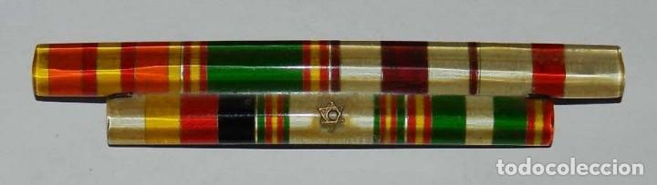 PASADOR CON 7 CINTAS CON LAS MEDALLAS DE LA CAMPAÑA DE SIDI-IFNI, CRUZ AL MERITO POLICIAL, 25 AÑOS D (Militar - Cintas de Medallas y Pasadores)