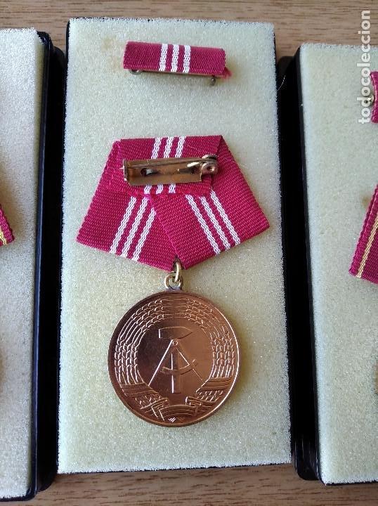 Militaria: Medallas DDR (1949-1990) , colección de 11 medallas originales en muy buen estado. - Foto 8 - 266121483