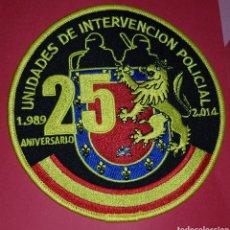 Militaria: PARCHE UNIDADES DE INTERVENCIÓN POLICIAL 25 ANIVERSARIO 1989/2014. Lote 188479253