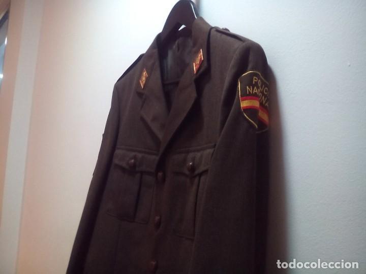 Chaqueta y abrigo tres cuartos Policía Nacional marrón