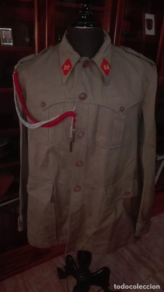 SAHARIANA COMPLETA. REGLAMENTO 1943. ALFEREZ MILICIAS UNIVERSITARIAS. SIN USO. (Militar - Uniformes Españoles )
