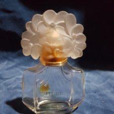 Miniaturas de perfumes antiguos: FRASCO DE COLONIA VACÍO FLORE CAROLINA HERRERA. Lote 146146870