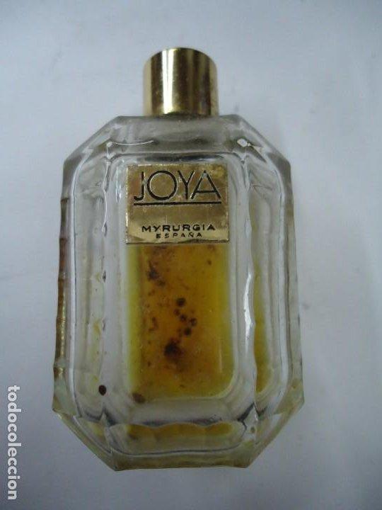 BOTELLA JOYA DE MYRURGIA ES DE LOS AÑOS 1920 LA BOTELLA CON UN PEQUEÑO RESTO DE PERFUME (Coleccionismo - Miniaturas de Perfumes)