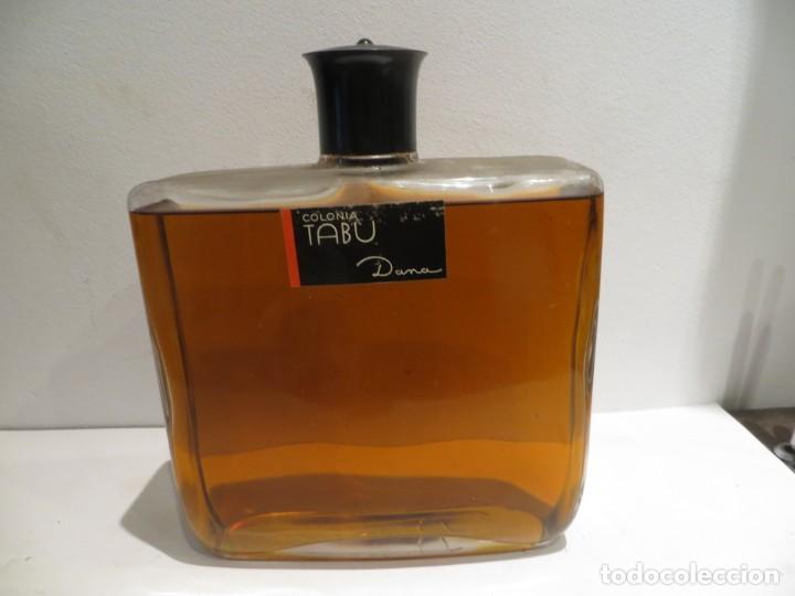 TABU ANTIGUA BOTELLA COLONIA DE DANA MUY GRANDE EN BUEN ESTADO Y LLENA (Coleccionismo - Miniaturas de Perfumes)