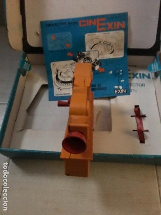 Hobbys: Cinexin antiguo - waly Disney CON 4 PELICULAS CINE EXIN AZUL AÑOS 70 ENCIENDE BOMBILLA - Foto 3 - 197424047