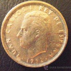 Coins with Errors - 10 pesetas 1992 Juan Carlos I barra de metal detrás de la nuca - variante muy marcada - 27119023