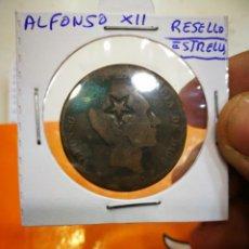 Monedas con errores: MONEDA RESELLO ALFONSO XII 10 CÉNTIMOS RESELLO O MARCA DE ESTRELLA DE EPOCA. Lote 147634174