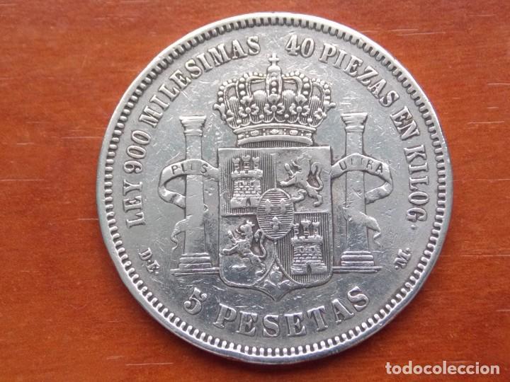 Monedas de España: DURO DE PLATA 5 PESETAS ALFONSO XII REY DE ESPAÑA.1875.LEY 900 MILÉSIMAS 40 PIEZAS EN KILOG. D·E ·M· - Foto 2 - 158433454