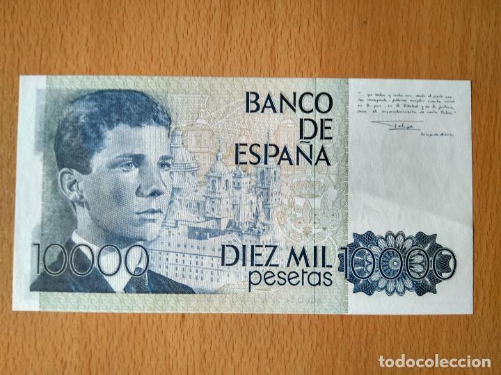 Monedas Juan Carlos I: BILLETE 10000 PESETAS BANCO DE ESPAÑA MADRID AÑO 1985 JUAN CARLOS I PRINCIPE ASTURIAS EL ESCORIAL - Foto 2 - 244012805