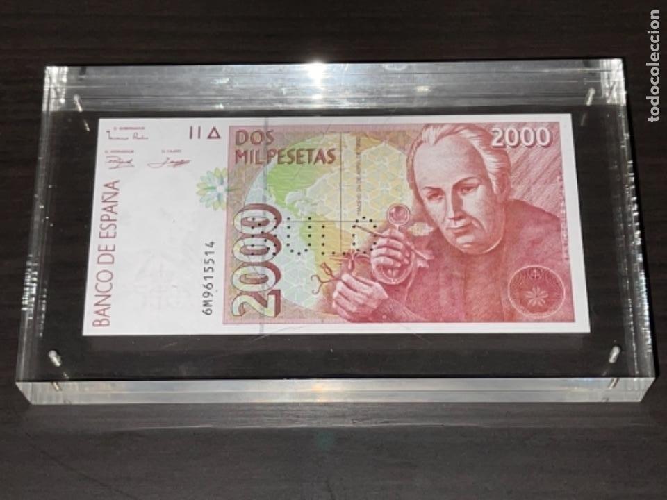 Monedas Juan Carlos I: NULO!! MUY RARO BILLETE DE ESPAÑA DE 2000 PTAS CON PERFORACION DE NULO SIN CIRCULAR - Foto 10 - 257891760