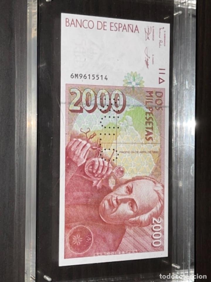Monedas Juan Carlos I: NULO!! MUY RARO BILLETE DE ESPAÑA DE 2000 PTAS CON PERFORACION DE NULO SIN CIRCULAR - Foto 12 - 257891760