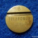 Monedas locales: FICHA TELÉFONO - TELÉFONOS - B - RANURA A CADA LADO DESCENTRADA - . Lote 114662151