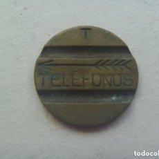 Monedas locales: FICHA ANTIGUA PARA CABINA TELEFONICA . TELEFONOS. Lote 128400484