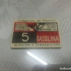 Monedas locales: RARO VALE DE 5 LITROS DE GASOLINA DELEGACIÓN DE ABASTECIMIENTO Y TRANSPORTE PROVINCIA DE CÁDIZ 1952. Lote 175303750