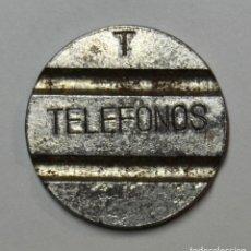 Monedas locales: BONITA Y RARA FICHA DE TELEFONOS - LETRA T PUNZADA DE LA COMPAÑIA NACIONAL TELEFONICA - LOT. 3834. Lote 269291923