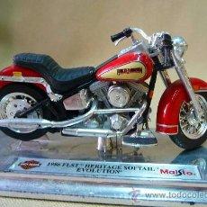 Motos a escala: MOTO, MAISTO, HARLEY DAVIDSON, 1986 FLST, HERITAGE SOFTAIL EVOLUTION, EN PEANA, ESCALA 1/18, CAB. Lote 28437869