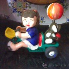 Muñeca española clasica: TRICICLO DE CUERDA DE PASTA PINTADO A MANO AUTOMATA. Lote 27422067
