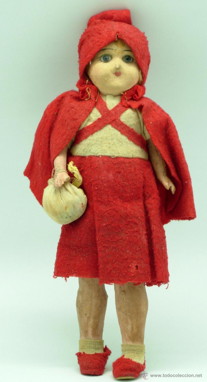 juguete cabeza roja