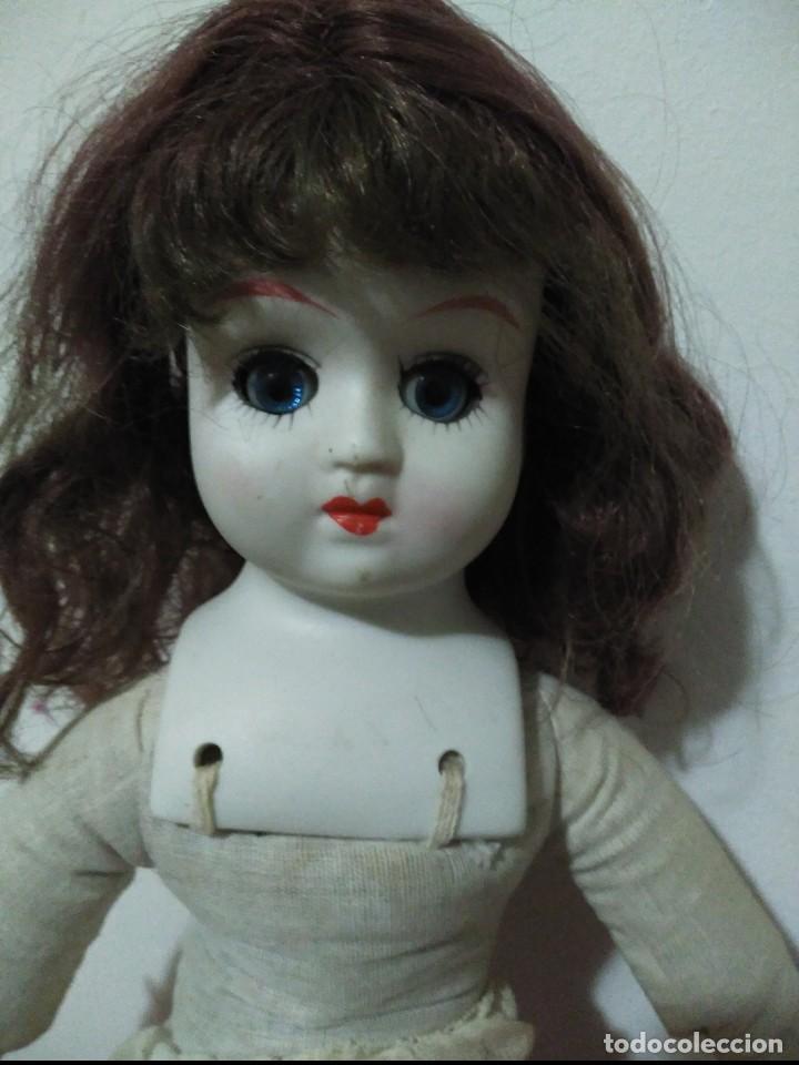 Muñecas Porcelana: antigua muñeca cabeza ,manos y pies en biscuit,botas en piel. resto de trapo - Foto 6 - 65956354