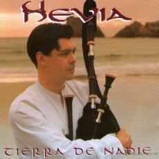 CDs de Música: HEVIA - TIERRA DE NADIE - CD ALBUM - 11 TRACKS - HISPAVOX EMI ODEON 1998 + REGALO CD SINGLE. Lote 39847721