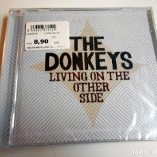 CDs de Música: THE DONKEYS LIVING ON THE OTHER SIDE CD FOLK ROCK, COUNTRY ROCK. Lote 110045215