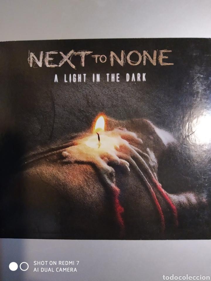 NEXT TO NONE. A LIGHT IN THE DARK (Música - CD's Otros Estilos)