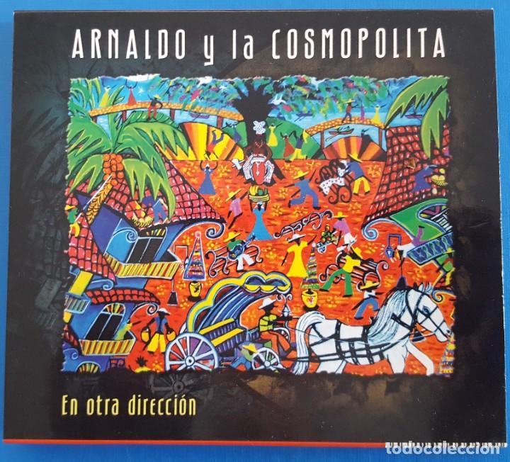 CD / ARNALDO Y LA COSMOPOLITA – EN OTRA DIRECCIÓN / LUJURIA – L-0018, 2008 HOLANDA COMO NUEVO (Música - CD's Latina)