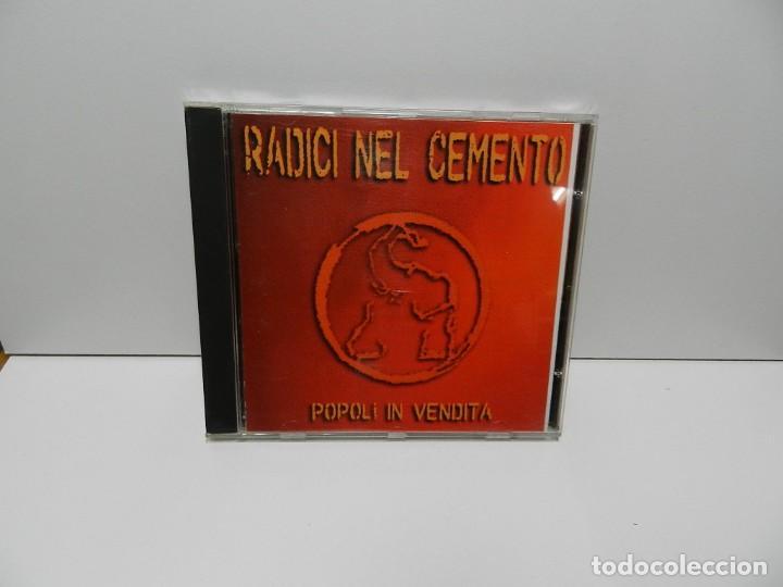 DISCO CD. RADICI NEL CEMENTO – POPOLI IN VENDITA. COMPACT DISC. (Música - CD's Reggae)