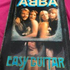 Partituras musicales: LIBRO PARTITURAS PARTITURA ABBA EASY GUITAR APRENDER A TOCAR LA GUITARRA LP CD SINGLE MAXI FOTO DVD. Lote 243333595
