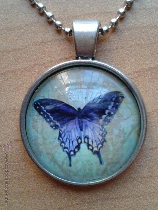 Nuevo: Colgante color plata con cabuchón y dibujo de mariposa sobre fondo verdoso. Incluye cadena. Nuevo. - Foto 4 - 212482132