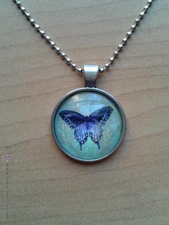 Nuevo: Colgante color plata con cabuchón y dibujo de mariposa sobre fondo verdoso. Incluye cadena. Nuevo. - Foto 5 - 212482132