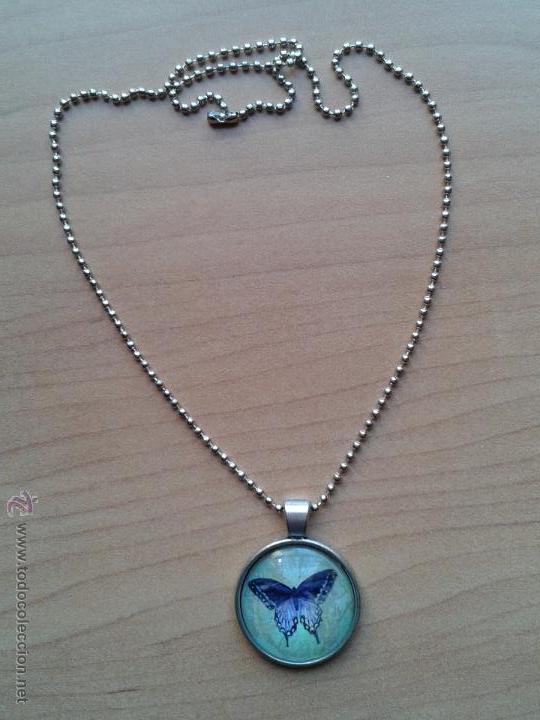 Nuevo: Colgante color plata con cabuchón y dibujo de mariposa sobre fondo verdoso. Incluye cadena. Nuevo. - Foto 6 - 212482132