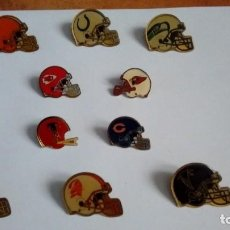 Coleccionismo deportivo: PINS 10 CASCOS EQUIPOS DE LA NFL. Lote 115610051