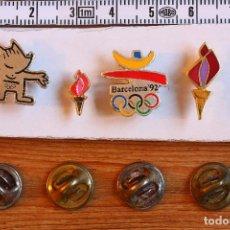 Coleccionismo deportivo: LOTE DE 4 PINS LOGO - MASCOTA COBI Y ANTORCHAS OLIMPIADAS BARCELONA 1992. Lote 235047155