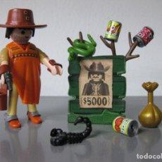 Playmobil: PLAYMOBIL BANDIDO OESTE VAQUERO FUJITIVO CON BOTIN Y BOTES PARA ENTRENAR DISPARO. Lote 128696139