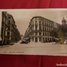 Postales: TARJETA POSTAL. MALAGA-CALLE LARIOS. FOTO L. ROISIN. Lote 94504986