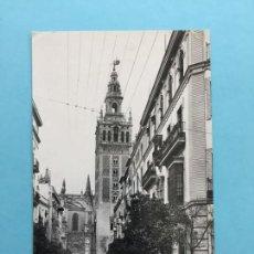 Postales: POSTAL LA GIRALDA DESDE LA CALLE DE MATEO GAGO SEVILLA _LEY218. Lote 131747290