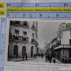 Postales: PEQUEÑA FOTO POSTAL DE HUELVA. AÑOS 30 50.BANCO HISPANO AMERICANO CALLE GENERAL MOLA. 0. Lote 183211395