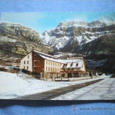 Postales: POSTAL HUESCA TORLA HOTEL ORDESA CAMPING INVIERNO AL FONDO MONDARRUEGO NO CIRCULADA. Lote 17560603