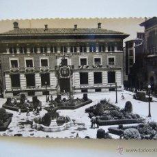 Postales: POSTAL FOTOGRÁFICA. BANCO DE ESPAÑA. TERUEL. PLAZA DEL GENERAL VARELA. CIRCULADA 1957.. Lote 40266387