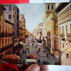 Postales: POSTAL HUESCA COSO ALTO Y CORREOS N 4 DANIEL ARBONES VILLA AMPA 1964 ESCRITA Y SELLADA. Lote 268882559