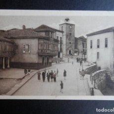Postales: LUANCO ASTURIAS CALLE DEL RELOJ POSTAL ANTIGUA. Lote 170532140