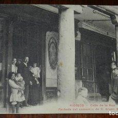 Postales: POSTAL DE RIOSECO, VALLADOLID, CALLE DE LA RUA. FACHADA DEL COMERCIO DE D. BRUNO MERINO, CASA EDITOR. Lote 133847734