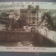 Postales: ANTIGUA POSTAL CEUTA CALLE DE LA LIBERTAD ESCRITA Y CIRCULADA A BAÑOS DE BUSOT ALICANTE 1939. Lote 31665742