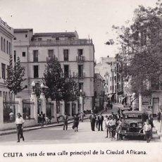Postales: CEUTA VISTA DE UNA CALLE PRINCIPAL DE LA CIUDAD AFRICANA. ED. FOTO RUBIO Nº 64. SIN CIRCULAR. Lote 207210245
