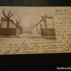 Postales: EL ESCORIAL MADRID CALLE DEL BARRIO OBRERO PUBLICIDAD CHOCOLATES MATIAS LOPEZ. Lote 166018430