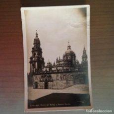 Postales: POSTAL SANTIAGO TORRE DEL RELOJ Y PUERTA SANTA. Lote 95859463