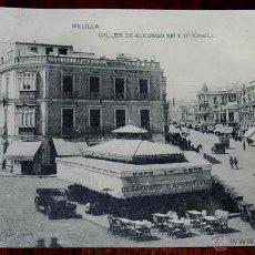 Postales: ANTIGUA POSTAL DE MELILLA, CALLES DE ALFONSO XIII Y ODONELL, LA PAPELERA AFRICANA, FOTOTIPIA HAUSER . Lote 39610551