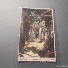 Postales: TETUAN - 204 , MOROS EN LA CALLE ED. ARRIBAS POSTAL ILUMINADA CON ANILINAS , CIRCULADA 1950 . Lote 58201663